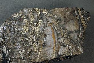 Ore genesis - Image: Auriferous brecciated quartz adularia rhyolite (Sleeper Rhyolite Gold Ore, Nevada) 1 (14719259472)