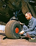 Aviation Mechanic with Lockheed 12A Electra Junior (11429472756).jpg