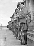 Australian guard of honour on Remembrance Day, 1943, resting on arms reversed