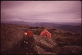BACKPACKER CAMP AT THE SUMMIT OF ALGONQUIN MOUNTAIN LOOKING WEST TOWARDS LAKE PLACID, NEW YORK, IN THE ADIRONDACK... - NARA - 554514.tif