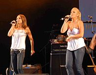 Bananarama live in Audley End, Essex, UK, 28 July 2007.  L–R: Keren Woodward and Sara Dallin