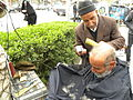Barber on the sidewalk of a street in Nishapur 4.JPG