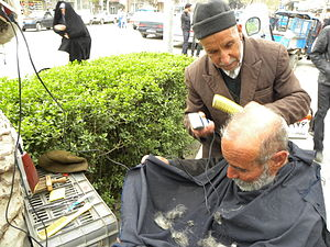 Mathematical problem - Image: Barber on the sidewalk of a street in Nishapur 4