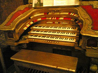 "Bartola Musical Instrument Company - Console of the 3/13 Barton Theater Pipe Organ at Ann Arbor's Michigan Theater, showing Barton's special red and gold console decoration which came to be known as ""circus wagon"" style."