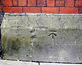Benchmark on building in Deansgate - geograph.org.uk - 2136640.jpg