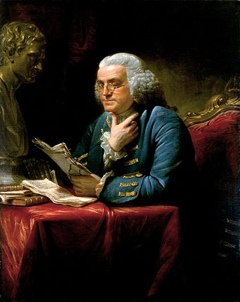 Franklin in London, 1767, wearing a blue suit with elaborate gold braid and buttons, a far cry from the simple dress he affected at the French court in later years. Painting by David Martin, displayed in the White House. Benjamin Franklin 1767.jpg