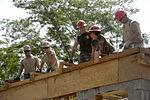 Bond beam work at Gabriela Mistral School construction site 150622-F-LP903-386.jpg