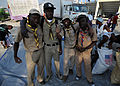 Boy Scouts with the Association Nationale des Scouts d'Haiti, stop to pose for a group photograph while they are providing relief at the soccer stadium in Port-au-Prince, Haiti 100216-N-HX866-006.jpg