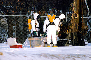 Superfund - Workers in hazmat suits check the status of a cleanup site