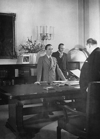Karl Hanke - Reichsminister Goebbels has a meeting with his Staatssekretär, Walther Funk, in his office at the Ministry. In the background, Referent des Ministers Karl Hanke takes a call.