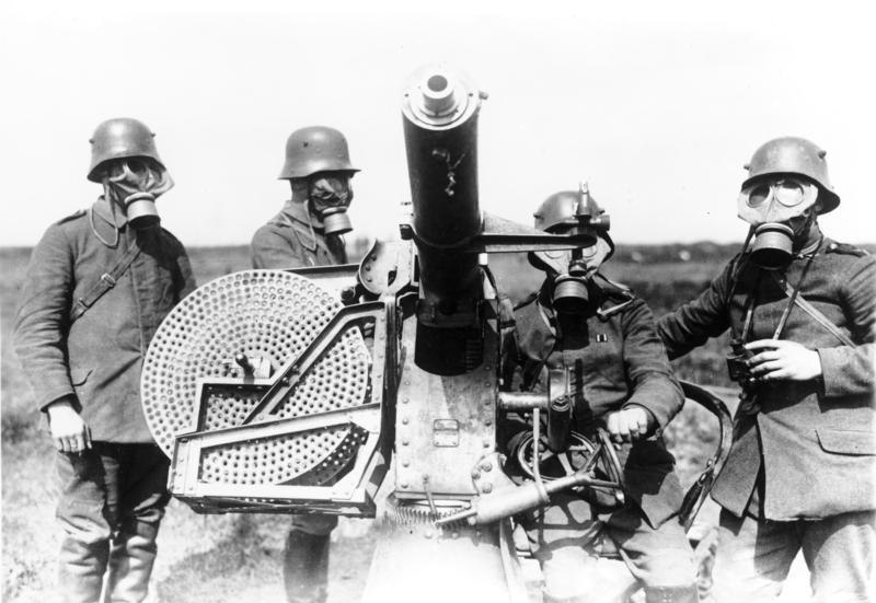 German gunners wearing gasmasks, with Maxim Flak M14