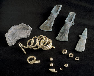 Welsh gold - The Bronze Age Burton Hoard, from Burton, Wrexham. The gold items are a folded torc, a twisted-wire bracelet, a necklace pendant, 4 beads and 3 rings (National Museum Wales).