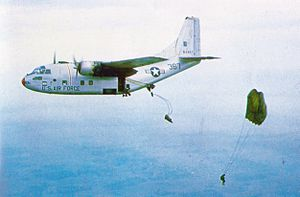 315th Operations Group - Vietnamese paratroopers jump from a group C-123B