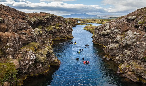 Snorkeling in the Silfra canyon, a continental drift between the tectonic plates (North American and Eurasian), Þingvellir National Park, Southern Region, Iceland.