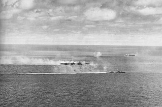 Japanese aircraft carrier Zuikaku - Zuikaku and destroyer Wakatsuki underway during U.S. carrier plane attacks. The carrier Zuiho is in the background.