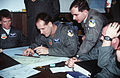 Captains Jason Funk (left), John Hruby, and Bruce Edwards (right), members of the 523rd Fighter Squadron, Cannon Air Force Base, New Mexico, prepare their flight plans F-3303-SPT-95-000001-XX-0081.jpg