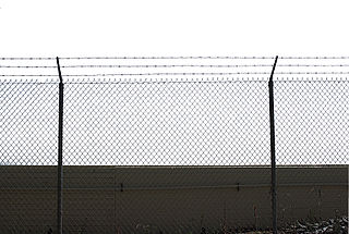 http://upload.wikimedia.org/wikipedia/commons/thumb/a/a3/Chainlink_fence_no_background.jpg/320px-Chainlink_fence_no_background.jpg