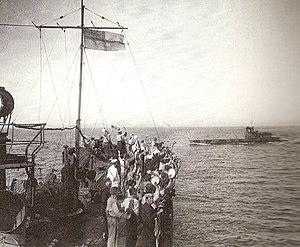 Naval operations in the Dardanelles Campaign - The crew of HMS Grampus cheering E11 after a successful operation.