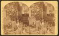 Christmas tree with toys around, including doll houses, by Roberts & Fellows 2.png