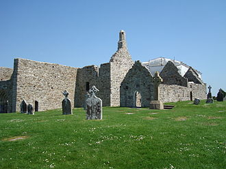 Clonmacnoise - Clonmacnoise Cathedral from the south-east (centre and left), Temple Doolin and Temple Hurpan (right) and Temple Melaghlin (behind, covered)