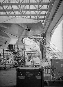 Concorde undergoing a service Technical Block A, Heathrow Airport.jpg