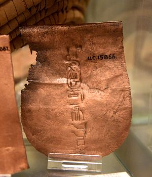 Deir el-Bahari - Copper plate, probably part of an axe-blade, showing cartouche of Hatshepsut. Foundation deposit in a small pit covered with a mat, Deir el-Bahri, Egypt. 18th Dynasty. The Petrie Museum of Egyptian Archaeology, London