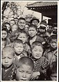 Crowds of Japanese boys and a few girls (1915 by Elstner Hilton).jpg