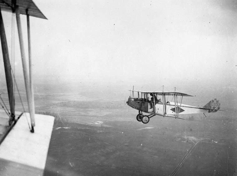 Curtiss JN-4 in flight over Central Ontario