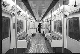 London Underground D78 Stock - D78 stock interior as built, photograph taken during press run, 9 January 1980. Moquette was orange/brown rectangle pattern. Windows were non-opening; hopper ventilators were fitted after complaints of poor ventilation.