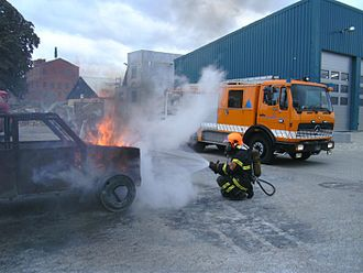 Danish Emergency Management Agency - DEMA Volunteer extinguishing a car fire during a training exercise