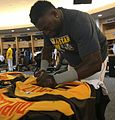 David Ortiz signs a jersey in the AL clubhouse before the -ASG (28444283655).jpg