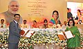 Dharmendra Pradhan and the Chief Minister of Rajasthan, Smt. Vasundhara Raje Scindia witnessing the signing ceremony of an MoU between HPCL and Government of Rajasthan, in Jaipur, Rajasthan.jpg