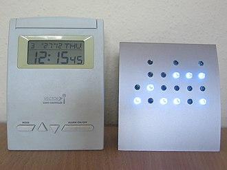 Binary clock - Both clocks read 12:15:45.
