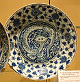 Dish with a dragon in fiery clouds, black seal-mark on base, Iran, Kirman, early 17th century, underglaze-painted stonepaste - Royal Ontario Museum - DSC04801.JPG