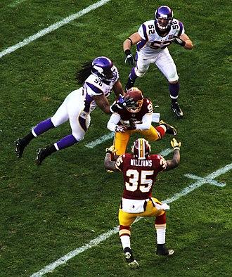 2010 Minnesota Vikings season - E.J. Henderson makes an interception against Washington, week 12