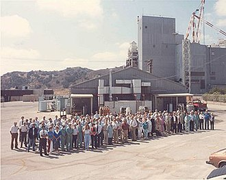 Energy Technology Engineering Center - Group photo of Energy Technology Engineering Center employees in 1989. The Sodium Pump Test Facility can be seen in the far background.