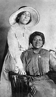 Eartha Mary Magdalene White 1910 with mother.jpg