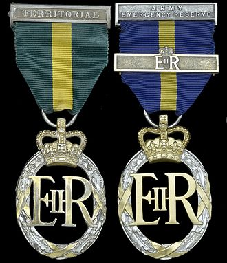 Emergency Reserve Decoration - Right: Emergency Reserve Decoration with 2nd award clasp. The badge is identical to the Elizabeth II version of the Efficiency Decoration, left