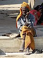 Elderly Man at Ghat - Varanasi - Uttar Pradesh - India (12480777783).jpg