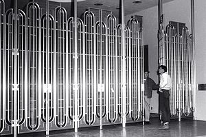 Marin County Civic Center - Entrances are controlled by vertical grills of gold-anodized metal, 1963.