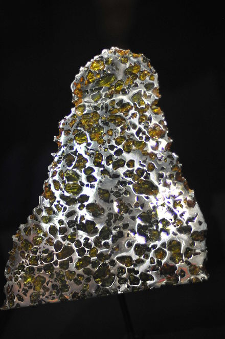 A slice of a pallasite meteorite fragment of what was once a meteoroid before it collided with Earth, discovered in Esquel, Argentina; on display at the Canadian Museum of Nature in Ottawa, Canada. - Meteoroid