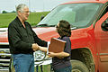FEMA - 44286 - A FEMA Individual Assistance officer with a homeowner in Oklahoma.jpg