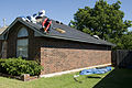 FEMA - 44633 - Roofer working on a home in Oklahoma.jpg