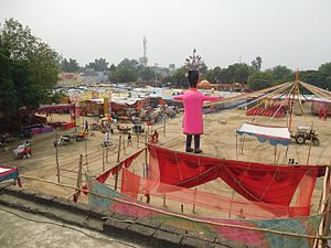 Ramlila - A rural Ramlila stage setup in progress in India. The large effigy is of Ravana who is destroyed at the end.