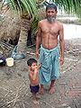 Father and son, Sunderban, India.jpg