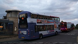 Bus transport in the United Kingdom - Privatised bus companies First Leeds and Transdev in Harrogate buses at Wetherby bus station.