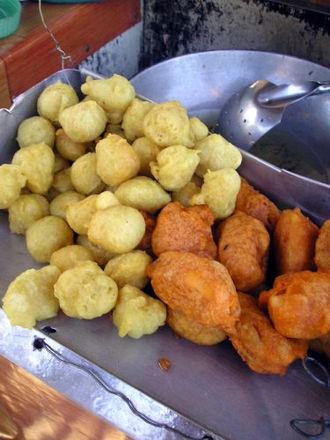 Fish ball - Fish balls and kwek kwek (hard-boiled quail eggs fried in orange-colored batter) in the Philippines