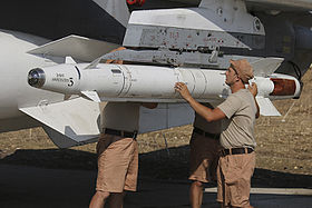 Fixing missiles to a Russian jet at Latakia (1).jpg