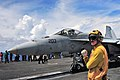 Flickr - Official U.S. Navy Imagery - A Sailor directs a jet on the flight deck..jpg