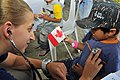 Flickr - Official U.S. Navy Imagery - Project Hope Volunteer Mary Beth Wargo checks a child's pulse during a Pacific Partnership 2012 medical civic action project..jpg